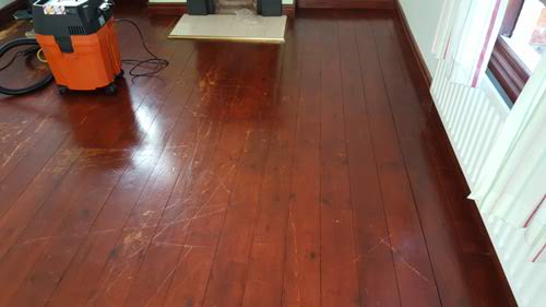 before picture, stained dark pine floor